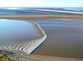 The tidal bore at Morecambe Bay