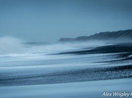 Waves crashing on a beach in Cumbria