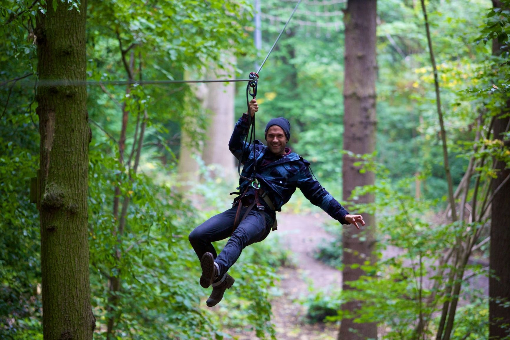 Image of a man on a zip wire in Grizedale Forest