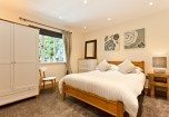The downstairs king sized bedroom at Weavers Cottage in Cartmel