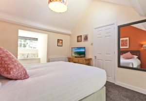 The upstairs king sized bedroom at Weavers Cottage in Cartmel