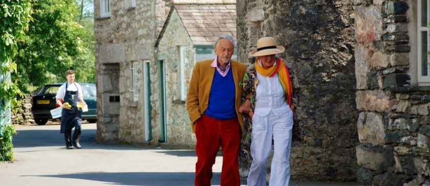 Stylish couple outside L'Enclume in Cartmel village