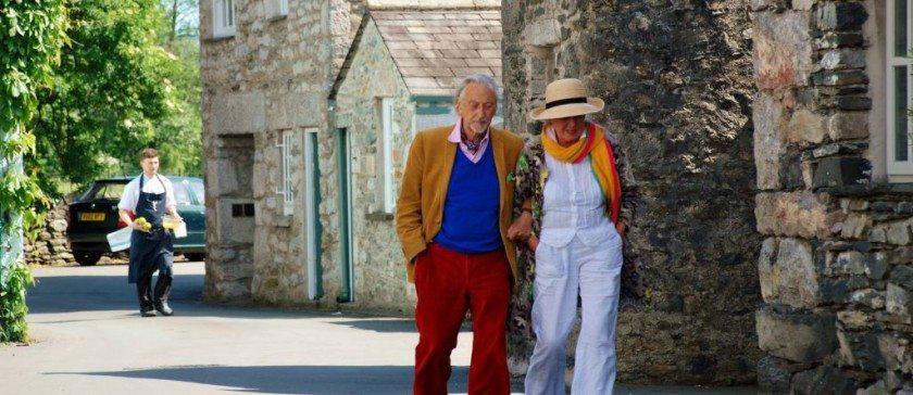 Stylish couple outside L'Enclume in Cartmel village