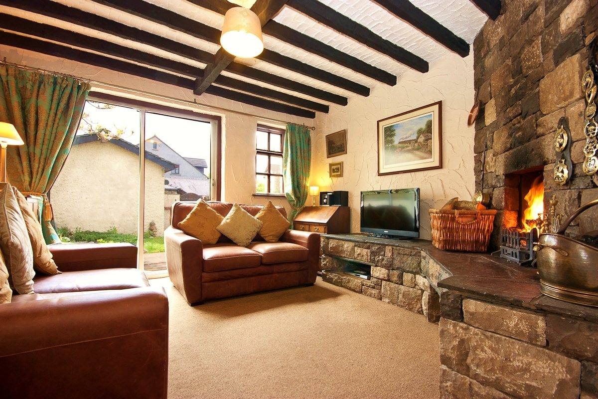The sitting room and roaring log fire