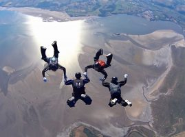 Image of sky divers over Morceambe Bay, Lake District