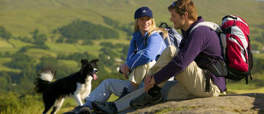 A couple with their dog in the Lake District