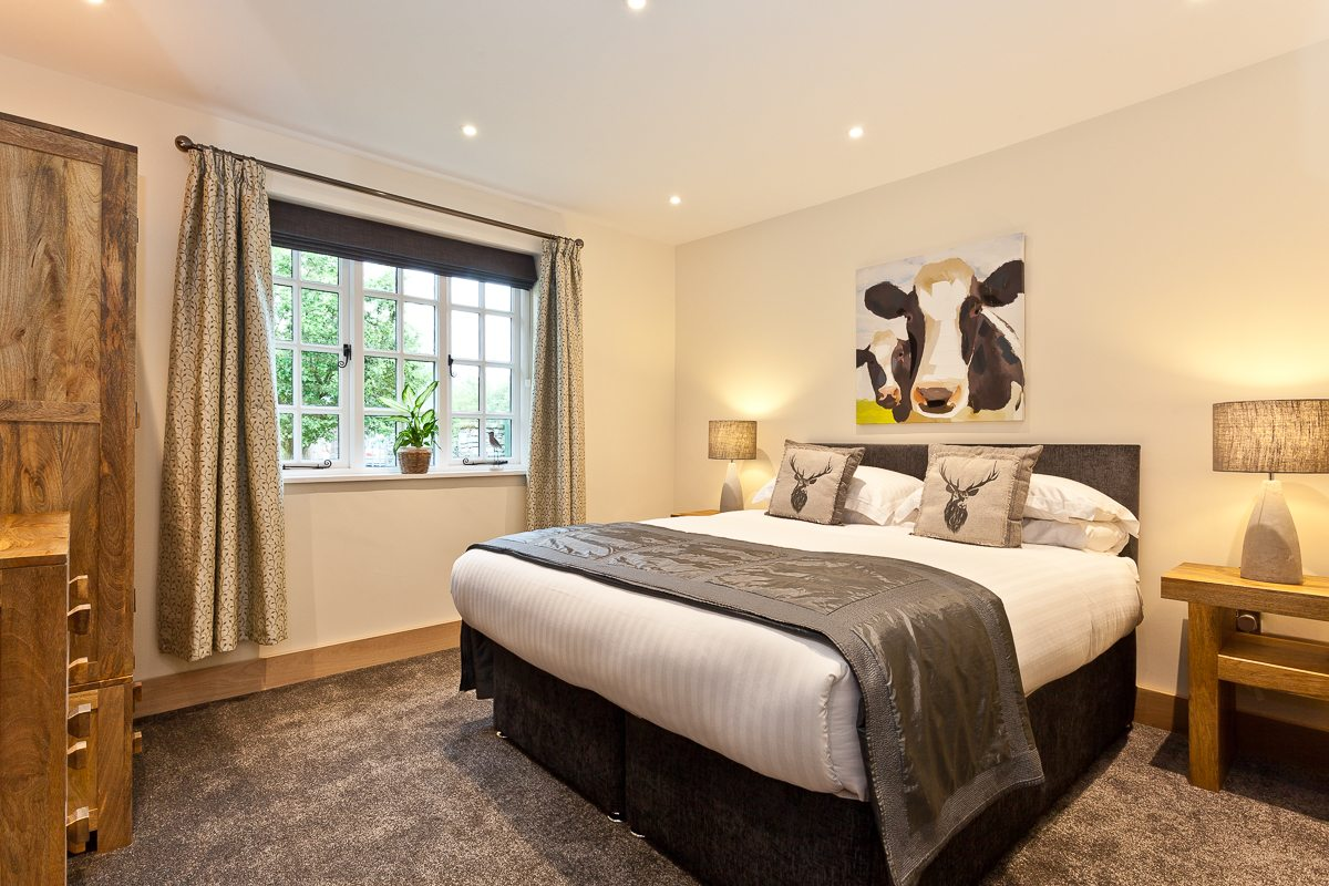 The lovely downstairs king sized bedroom at Weavers Cottage