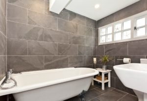 The large stylish bathroom with claw foot free standing bath