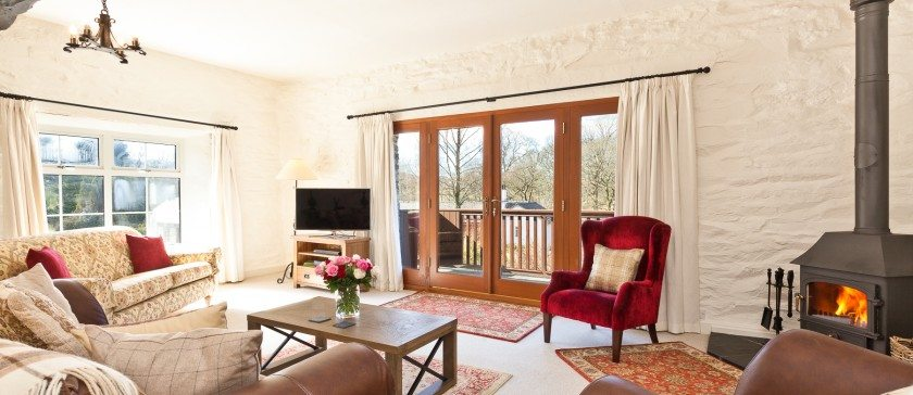 The sitting room and sunny balcony at Charcoal House
