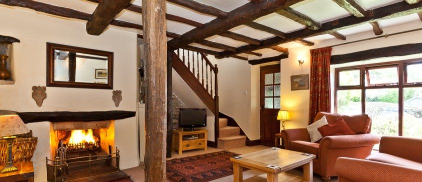 The Lounge and log fire in Carree Cottage