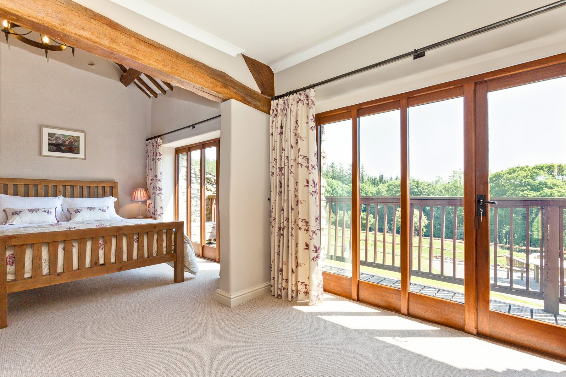 King sized bedroom with a veranda over-looking the fields