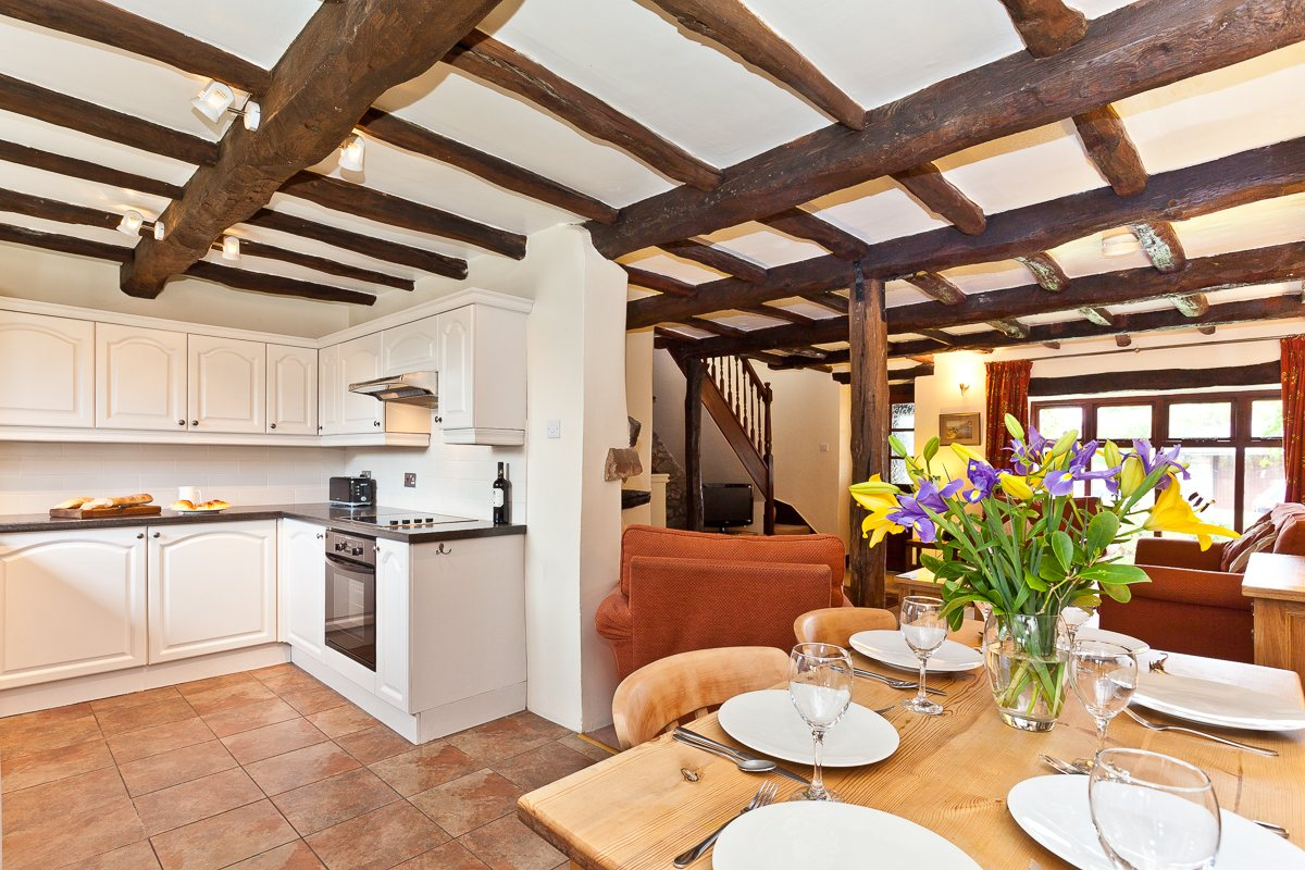 The kitchen, dining and sitting areas in Carree Cottage
